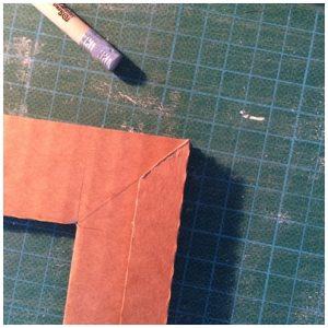 Angle de la bande de carton
