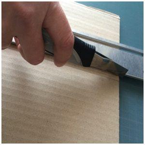 couper au cutter entre les cannelures